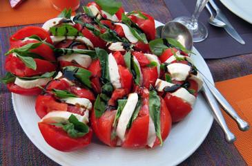 Fresh salad of red tomatoes, mozzarella, basil and balsamic vinegar