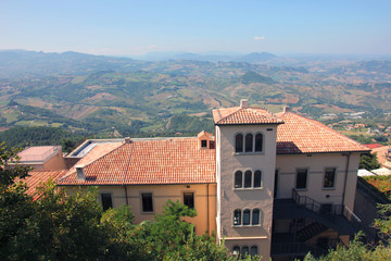 beautiful picturesque panoramic views of San Marino hills and red tiled roof of old gothic building vith tower