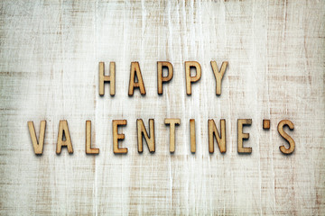 Valentine's Day letters on wooden background