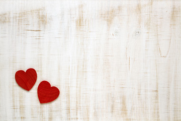 Red Valentine's Day hearts on wooden background