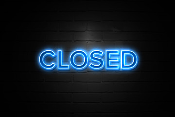 Closed neon Sign on brickwall