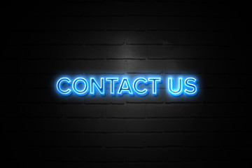 Contact Us neon Sign on brickwall