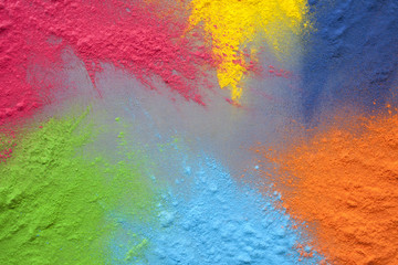 Bright colors for holi festival. Colorful holi paint (powder) splatted on a table with copy space