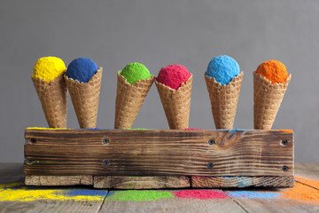 Festival of colors. Bright colours in shapes of ice cream scoops in cones for Indian holi festival. Colorful gulal (powder colors) for Happy Holi. Pigments.