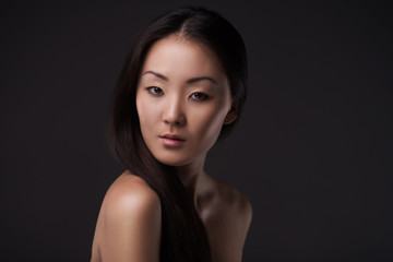 Beautiful Asian woman looking at camera