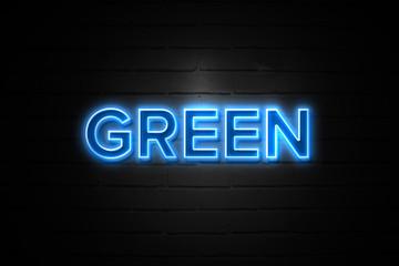 Green neon Sign on brickwall