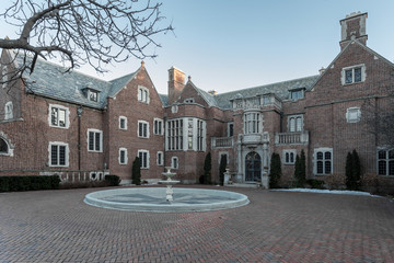 Empty mansion with brick driveway