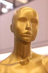 gold colored display dummy in a department store