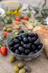 Greek black olives in the bowl served for snack.