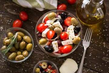 Greek salad with fresh vegetables, feta and black and green olives. Healthy fresh vegetarian food.
