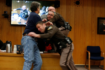 Randall Margraves lunges at Larry Nassar during victim statements of his sentencing in Charlotte