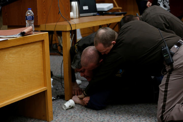Randall Margraves is tackled after he lunged at Larry Nassar during victim statements in Charlotte