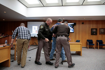 Randall Margraves is removed after he lunged at Larry Nassar during victim statements in Charlotte