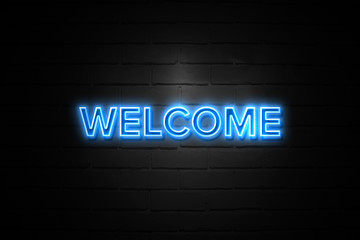 Welcome neon Sign on brickwall