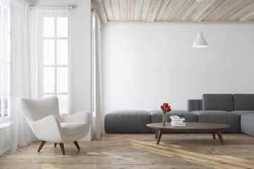 White living room with a gray sofa