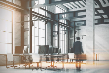Loft office corner, computer screens toned