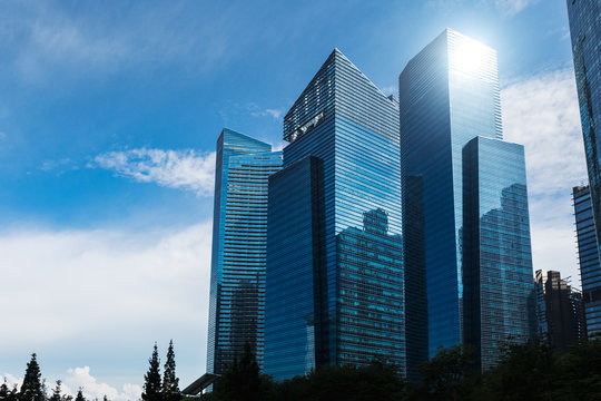 Modern blue skyscrapers at downtown district. Business landscape background. Singapore city