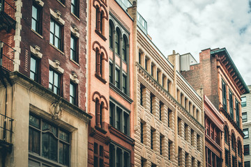 Row of vintage New York City apartment buildings in a variety of brick and brownstone facades Wall mural
