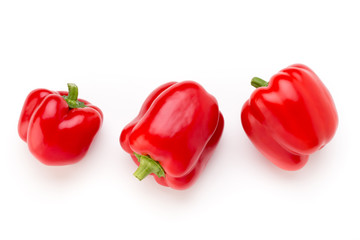 Red bell pepper with half and leaves isolated on white.