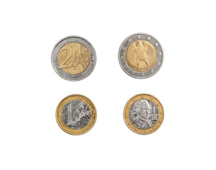 Front and back side of one and two euro coins isolated on white.