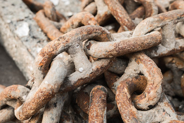 Old rusty chain at sea port; close-up