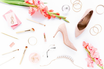Wall Mural - Beauty blog fashion concept. Female pink styled accessories: brushes, glasses, cosmetics, jewelry, shoes on white background. Flat lay, top view trendy feminine background.