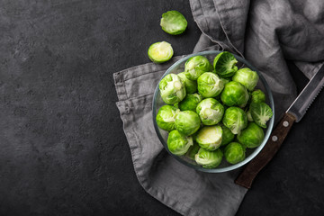Photo sur cadre textile Bruxelles fresh raw brussel sprouts in glass bowl.