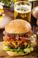 Homemade beef burger, caramelized onion, bacon and beer