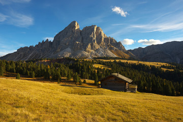 Small hut with a mountain on background, Dolomites, Italy