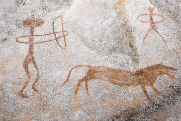 A scene of animal hunting performed ocher on the wall of the cave. Ancient people. stone Age. archeology