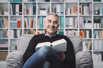 Man relaxing and reading a book