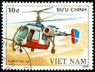Ukraine - circa 2018: A postage stamp printed in Vietnam show Soviet multipurpose helicopter Kamov Ka - 26. Circa 1988.