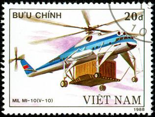 Ukraine - circa 2018: A postage stamp printed in Vietnam show Soviet helicopter Mil Mi -10. Circa 1988.