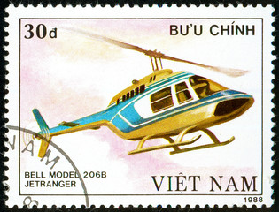 Ukraine - circa 2018: A postage stamp printed in Vietnam show multipurpose helicopter Bell Model 206B Jetranger. Circa 1988
