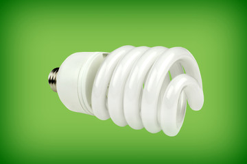 Saving bulb on green background