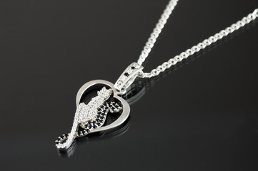 jewelery pendant in the form of a heart and two lovers cats silver metal