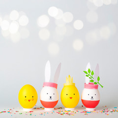 Easter holiday concept with cute handmade eggs: bunnies and chickens