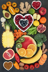 Healthy super food collection with fresh fruit, vegetables, nuts, pollen grain, herbs and spices with foods high in antioxidants, anthocyanins, fibre, omega 3, minerals and vitamins. Top view.