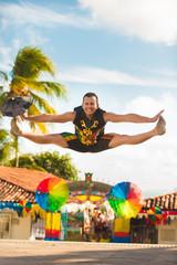 Brazilian Carnival. Man wearing carnival costumes and dancing in Olinda, Pernambuco, Brazil.