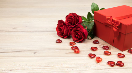 valentines day, red roses with hearts and a gift box on wooden board, Valentines Day background, wedding day