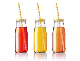three bottles of juice with straw isolated