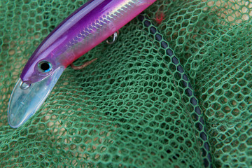 Fishing accessories on the green fishing net