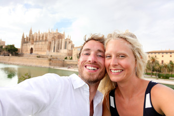 Aufkleber - Happy couple in love taking selfie photo with phone on summer vacation in front of the Palma Cathedral, La Seu, in Palma, Majorca, Spain. Europe travel holidays people having fun.