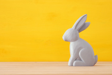 Cute wooden bunny over colorful background.
