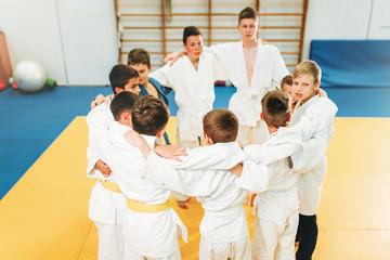 Boys in kimono on kid judo training indoor