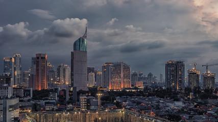 Wall Mural - Sunset over Jakarta city downtown