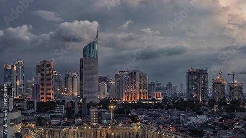 Fototapete Sunset over Jakarta city downtown