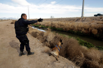 A police searches for James Martin Camacho Padilla, a missing 7-year-old boy with autism from Washington state, U.S., near a sewage canal in Ciudad Juarez