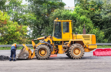 yellow forklift on road works