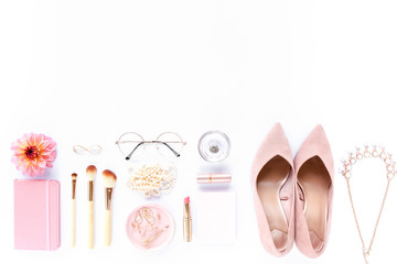 Wall Mural - Female pink styled accessories: watches, sunglasses, cosmetics, shoes on white background. Flat lay, top view trendy feminine background. Beauty blog fashion concept.